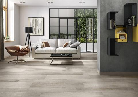 Wohnzimmer im großzügigen Loftstyle mit Holzfliesen - verlegt im Halbverband